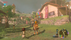 A screenshot of Breath of the Wild, with Link stood in the center of a small village.